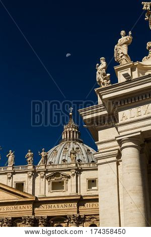Dome Of St Peters Basilica And Carvings On Top Of Colonnades, Vatican, With Moon.