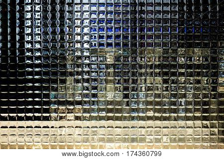 Glass block background crystal milky quartz pattern in restaurant behind is glass.