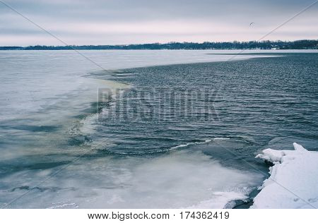 Old film stylized landscape with of Dnepr river at January in Dnepr city Ukraine