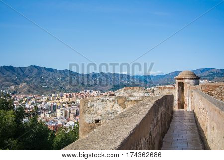A view from Alcazaba a fortress of Malaga to city and surroundings with mountains at the background Andalusia Spain.