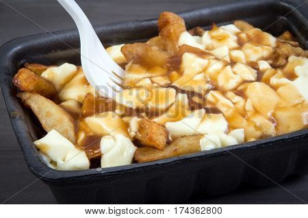 Poutine tray quebec meal with french fries gravy and cheese curds from a fast food restaurant