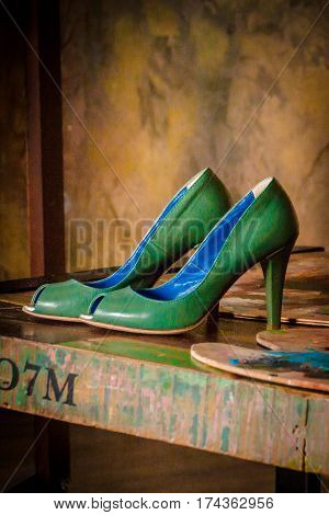 Luxury Green women's shoes. female green stylish shoes on the artist's palette. Fashionable green woman shoe