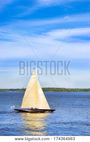 Sailing regatta in Bay Kruunuvuorenselka near island Suomenlinna. Sailing ship yacht with white sails involved in water sports. Marine navigation in sunny summer day. Suomi Helsingfors South Gulf