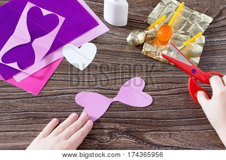 The Child Cuts Out A Paper Card Details. The Child Makes A Postcard Butterfly Hearts And Lollipop. C