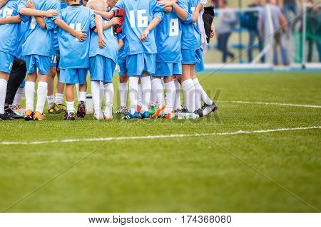 Coach giving children's soccer team instructions. Youth soccer team before final game. Football match for children. shout team football soccer game