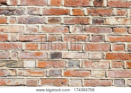 Lime mortar brick wall background showing repointing