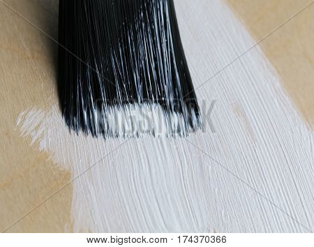 working brush paint a wooden floor white color