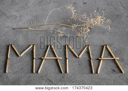 Abstract texture of concrete and matches. Against the backdrop of matches laid out the word