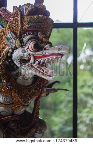 Colorful wooden carved statue of a deity in Indonesia