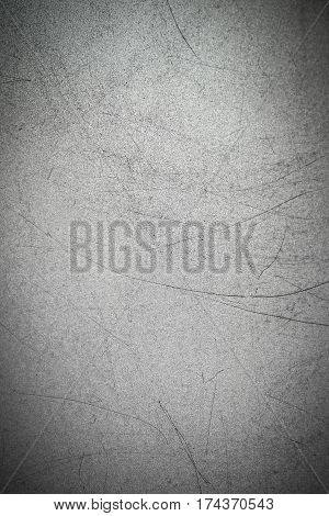 Texture of metal with long black scratches on the surface. Gray metallic background.