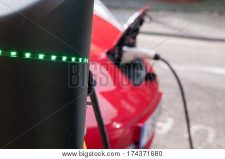 electric car charging to refuel at the charge station