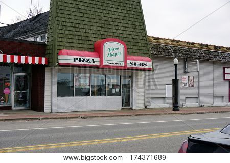 MANCELONA, MICHIGAN / UNITED STATES - NOVEMBER 27, 2016: One may eat pizza and sandwiches at the Pizza Shoppe, on State Street in downtown Mancelona.