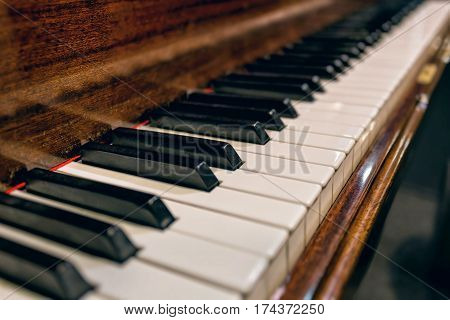 Close up view of piano keys. Old music instrument