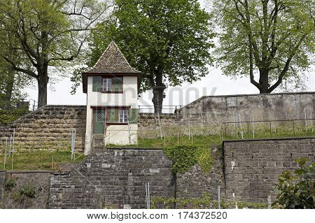 RAPPERSWIL SWITZERLAND - MAY 10 2016: A small watch tower at the wall that surrounds the castle grounds.