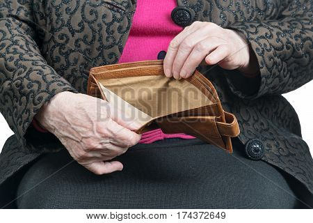 Empty wallet in the wrinkled hands of an old woman, close-up