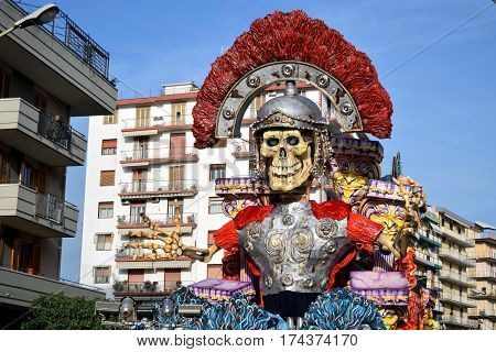 Acireale (CT) Italy - February 28 2017: allegorical float depicting a skeleton dressed as a Roman soldier during the carnival parade along the streets of Acireale.