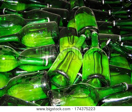 A multitude of green glass wine beer champagne bottles.