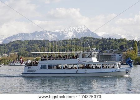 LUCERNE SWITZERLAND - MAY 04 2016: MS Dragon goes back to the harbor after completing a cruise on the waters of Lake Lucerne