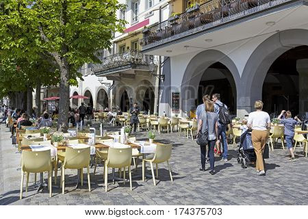 Lucerne Switzerland - May 08 2016: Outdoor seating restaurant. There are still places available but there are also people who are already seated at tables some people go.