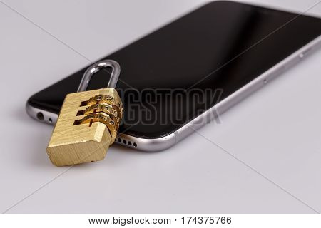 cellphone data security - lock and phone on white