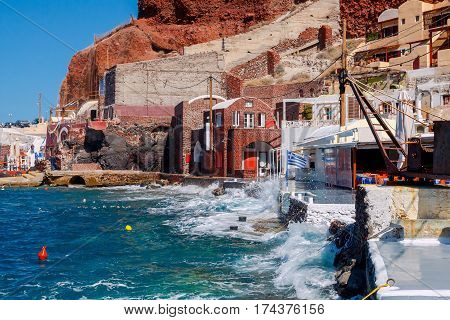 The old harbor of the village of Oia on Santorini bay, Greece.