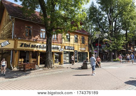 ZAKOPANE POLAND - SEPTEMBER 12 2016: Residential house at Krupowki street built of wood approx. 1890. There are retail stores and restaurant on the ground floor