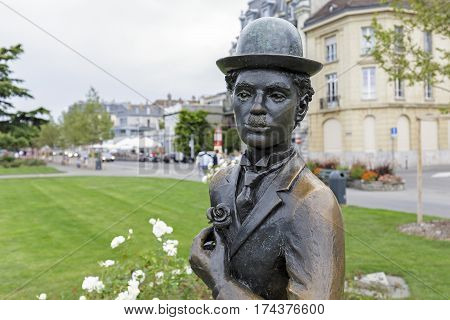 VEVEY SWITZERLAND - SEPTEMBER 12 2015: Detail of a statue made of bronze that in honor of Charlie Chaplin is set in a small resort town at the promenade on the Swiss Riviera