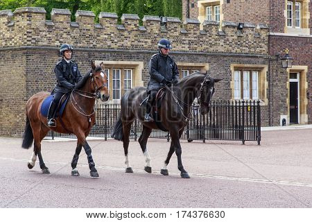 LONDON, GREAT BRITAIN - MAY 12, 2014: There are mounted police which patrols the aristocratic district of Westminster.