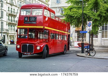 LONDON, GREAT BRITAIN - MAY 12, 2014: This is an old double-decker bus which is now used for tourism purposes.