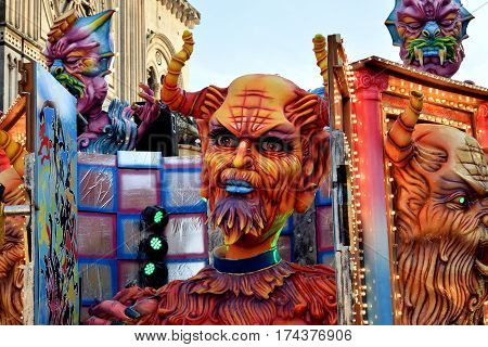 Acireale (CT) Italy - February 28 2017: detail of a allegorical float depicting a big red devil in a niche during the carnival parade along the streets of Acireale.