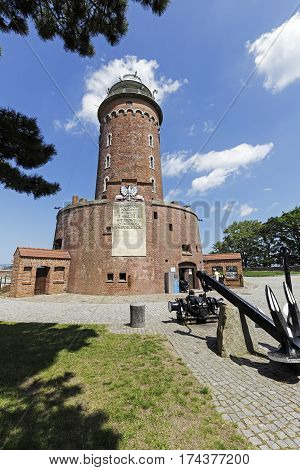 KOLOBRZEG POLAND - JUNE 22 2016: The lighthouse that is made of brick is one of the most recognizable and most visited tourist attractions in the city