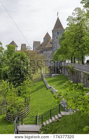 RAPPERSWIL SWITZERLAND - MAY 10 2016: The Castle during cloudy day is shown in a distance. It was built in the early 13th century and became the seat of the Polish National Museum since 1870