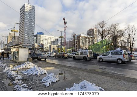 WARSAW POLAND - DECEMBER 03 2016: Urban scene shows buildings along the street Marszalkowska at the crossroad with Swietokrzyska street in the downtown. Traffic and a few people can be seen.
