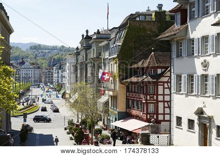LUCERNE SWITZERLAND - MAY 06 2016: Variety of historical architecture in the city center which can be seen along the avenue makes this city attractive travel destination for many sightseers.