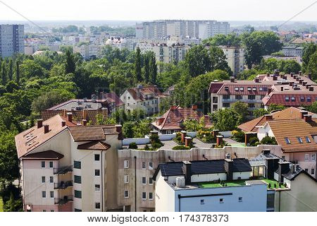 KOLOBRZEG POLAND - JUNE 25 2016: View towards residential buildings that are located among green areas in the city that offers significant number of apartments to rent due to holiday location