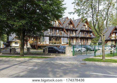 ZAKOPANE POLAND - SEPTEMBER 12 2016: Willa Pod Skocznia it is the main hotel building that was built in year 2011. This is a view of the side facade with visible sloping roofs.