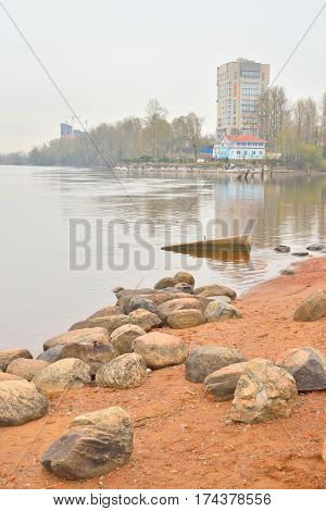 View of Neva River on the outskirts of St. Petersburg on a cloudy spring day in Russia.