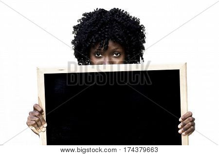 Girl holding blank chalkboard sign and looking at camera