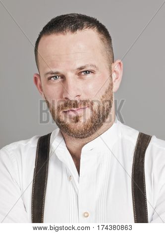 An image of a traditional bavarian young man with a beard