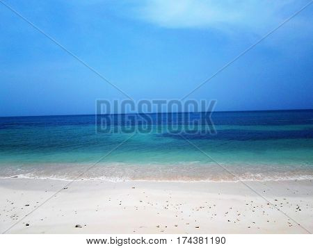White sand beach blue sea breeze and sun a perfect place to vacation.