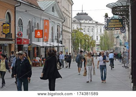 LJUBLJANA SLOVENIA - OCTOBER 13: Pedestrians at Copova Street in Ljubljana on OCTOBER 13 2014. People Walking at Pedestrian Zone in Ljubljana Slovenia.