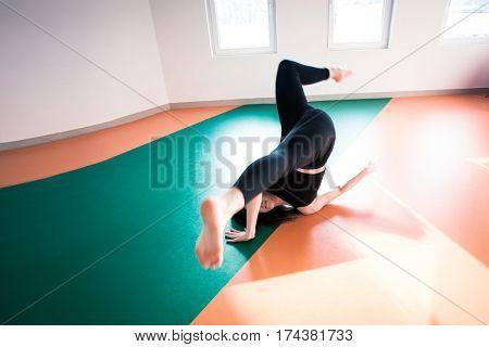young dancer woman practice floor jump on modern ballet class indoor shot