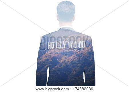 Back view of thoughtful young businessman daydreaming about Hollywood. Cinematography and fame concept. Double exposure