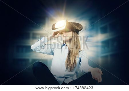 Woman wears virtual reality glasses with smartphone inside. vr glasses virtual reality glass abstract light futuristic concept