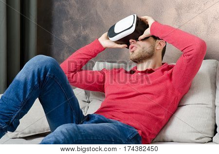 Man Wears Virtual Reality Glasses With Smartphone Inside