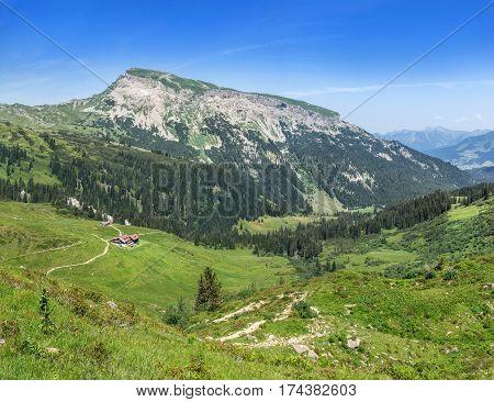 View to the mountain Hoher Ifen over the mountain hut Schwarzwasserhuette and the valley Schwarzwassertal in the Allgau Alps, Austria.