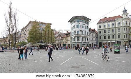 LJUBLJANA SLOVENIA - OCTOBER 13: Pedestrians at Preseren Square in Ljubljana on OCTOBER 13 2014. People Walking at Pedestrian Zone in Ljubljana Slovenia.