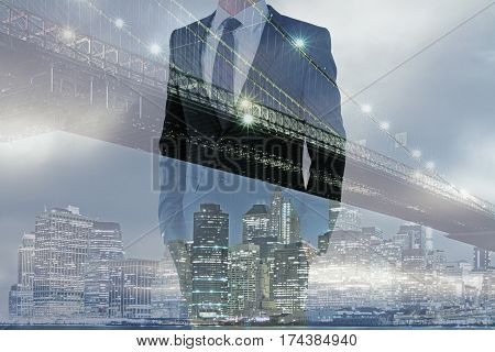 Front view of businessman wearing suit and tie on city background with copy space.Tomorrow concept. Double exposure