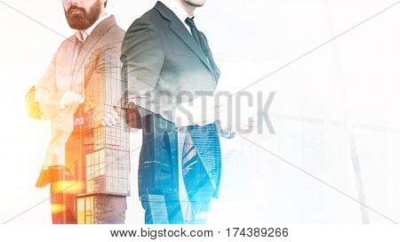 Close up of an unrecognizable business duo. One businessman is holding documents his partner is standing with crossed arms. Orange city. Double exposure mock up toned image