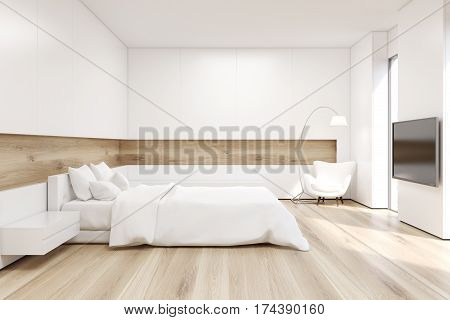 Side view of bedroom with a double bed with white covers in a room with wooden walls and floor. A TV set is hanging on a white wall. 3d rendering. Mock up.